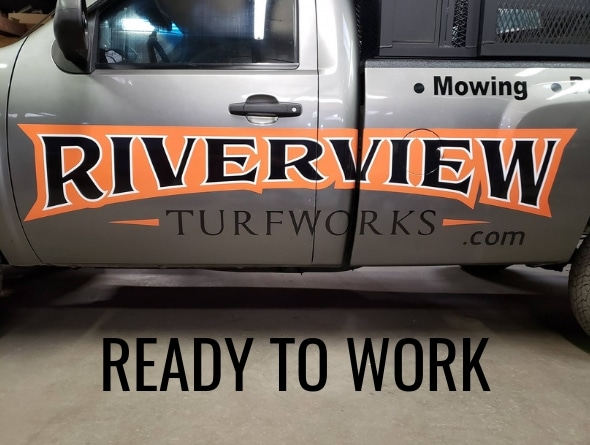 A close up of Riverview Turfworks' logo printed on the side of one of their work trucks.