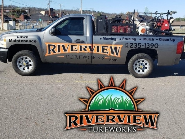 A Riverview Turfworks truck bearing the company's logo and phone number.